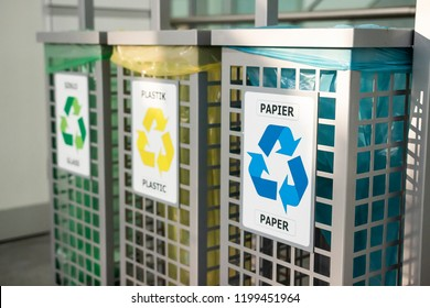 Recycling concept. bins for different garbage. Waste management concept. Waste segregation. Separation of waste on garbage cans. Sorting waste for recycling. Disposal. Colored bins with trash