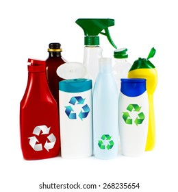 Recycling concept - garbage as empty plastic containers and bottles with recycling symbol