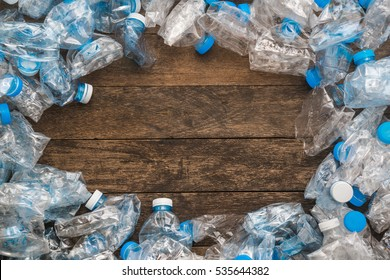 Recycling concept. The problem of ecology, environmental pollution. Background of plastic bottles transparent blue net. In the center of an empty space for writing.