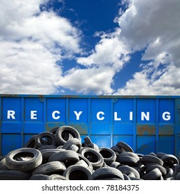 Recycling container and car tires over blue sky, business and ecology