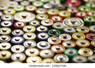 Recycling. Dozens of types, sizes, colors of used batteries and accumulators. Macro.