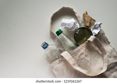 Recycling is in ecobag. Plastic bottle, glass bottle, tin can, paper in shopper bag. Top view with copyspace