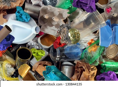 Recycling garbage and reusable waste management as old paper glass metal and plastic household products to be reused as a concept of environmental conservation of material saving energy and money.
