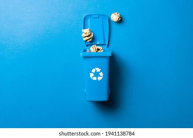 Recycling icon. Bin container for disposal garbage waste and save environment. Blue dustbin for recycle paper trash isolated on blue background
