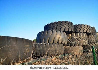 recycling old tyres on pile rubber junkyard