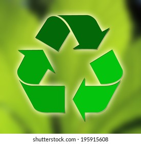 Recycling sign against green leaf background