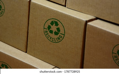 Recycling stamp printed on cardboard box. Recycle symbol, arrows, recyclable materials, environmental protection and earth safe concept. - Shutterstock ID 1787728925