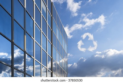 Recycling symbol made of clouds next to a modern office building.