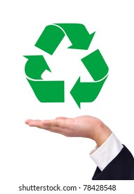 Recycling symbol on a business man's hand isolated on white.