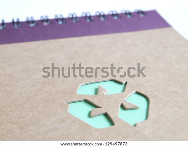 recycling symbol on cardboard book