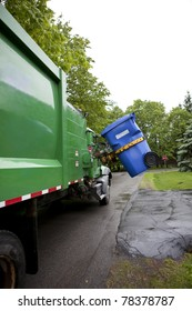 Recycling truck picking up bin - Vertical