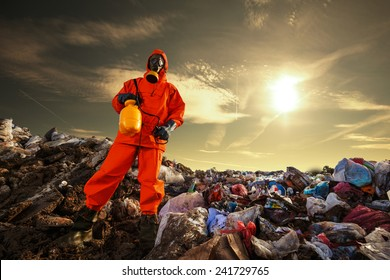 Recycling worker standing on the landfill