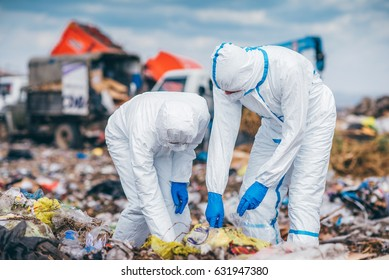Recycling workers researching on the landfill