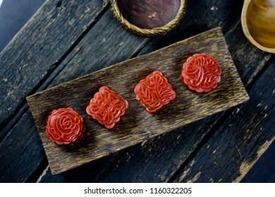 Red 4 mooncakes on wooden table