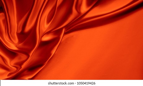 red abstract background luxury cloth or liquid wave or wavy folds of grunge silk texture satin velvet material or luxurious Christmas background or elegant wallpaper design, background