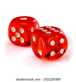 Red acrylic transparent dice for games. Two gambling translucent dices isolated on white background, macro close up high resolution.