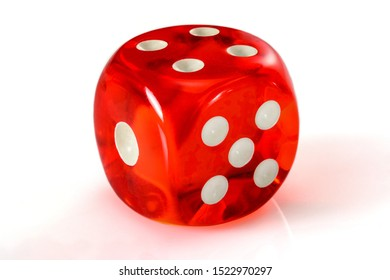 Red acrylic transparent dice for games. Gambling translucent dices on white background, macro close up high resolution.
