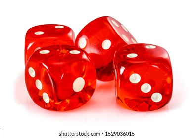 Red acrylic transparent dice for games. Four gambling translucent dices on white background, macro close up high resolution.