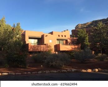 Red adobe casita in Sedona Arizona against deep blue sky