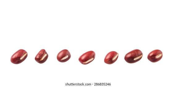 Red adzuki beans over white background
