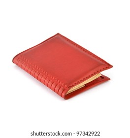 red aging note book on a white background