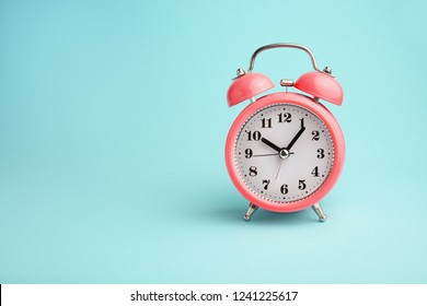 Red alarm clock on ablue background