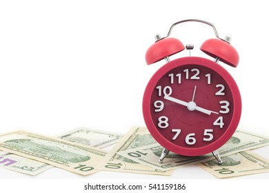 Red alarm clock on money banknotes Dollars,concept of business planning and finance