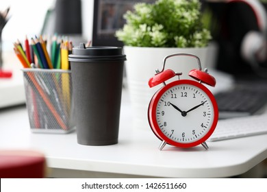 Red alarm clock on office table. Retro for concept design vintage style. Modern background. Time concept. Morning coffee cup concept. Copy space.