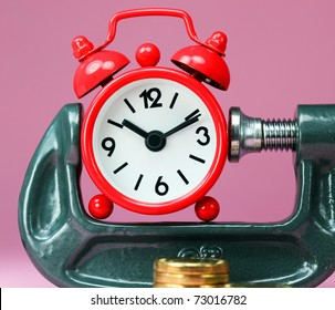 A red alarm clock placed in a Grey clamp against a pastel pink background, with a stack of gold coins in front of it, asking the question do you manage your time effectively?