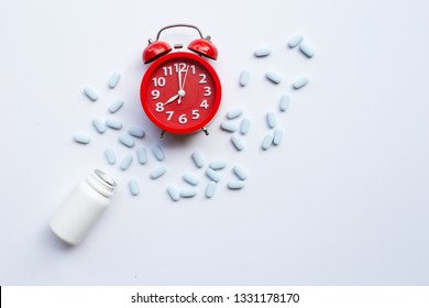 """Red alarm clock ring with """"PrEP"""" ( Pre-Exposure Prophylaxis). used to prevent HIV. Top view"""
