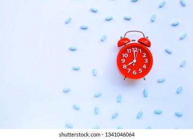 """Red alarm clock ring with """"PrEP"""" ( Pre-Exposure Prophylaxis). used to prevent HIV."""