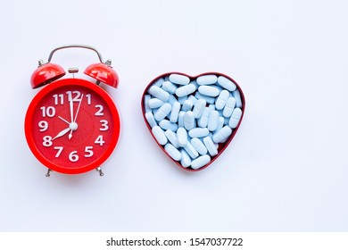 """Red alarm clock ring with """"PrEP"""" ( Pre-Exposure Prophylaxis). used to prevent HIV. Copy space"""