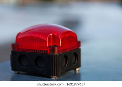 a red alarm light that flashes when there is a danger