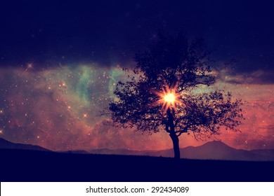 red alien landscape with alone tree silhouette - elements of this image are furnished by NASA