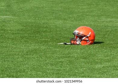 Red American Football helmet on astroturf