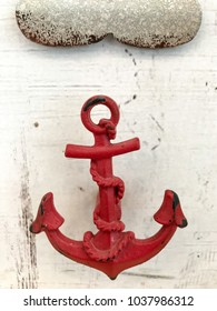 Red Anchor with wooden background