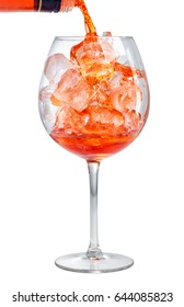red aperitif pouring into glass full of ice isolated on white background