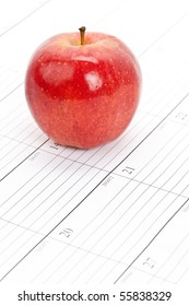 Red apple and Calendar close up