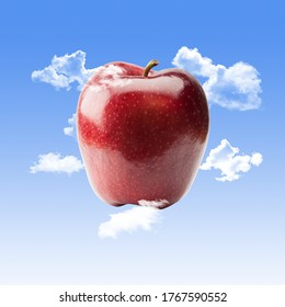 Red Apple with Clouds and a Blue Sky Background