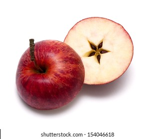 A red apple cut into two halves with a star in the middle.