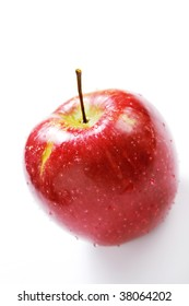 red apple with drop of water isolated on white background (shallow DOF)
