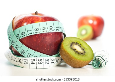 Red apple fitnes concept with centimeter. Weight loss fitness concept.