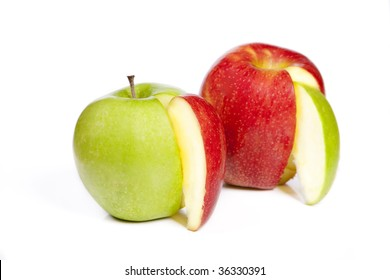 A red apple and green apple with alternating apple wedges over white.
