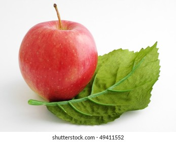 A red apple with a green leaf