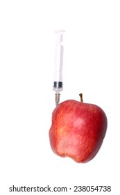 Red apple with a hypodermic syringe in it isolate on white