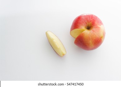 Red apple isolated on white background. Sliced.