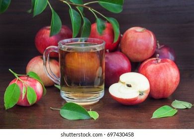 Red apple and juice or cider on background