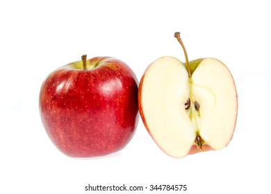 Red apple with leaf and slice on a white background