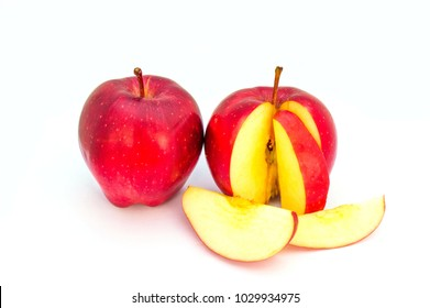 Red apple with leaf and apple slices isolated on a white background.