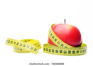 Red apple with a measuring tape on white